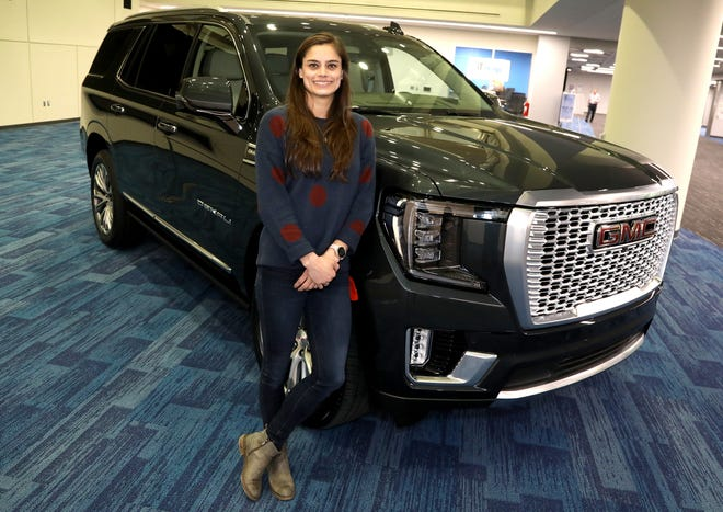 General Motors engineer Alex Archer with the 2021 GMC Yukon on Thursday, January 23, 2020 that she had a role in designing part of the interior.Archer worked on the new and innovative power console that with the push of a button can slide back and forth to revel lots of storage space giving owners an extra 10-cubic inches of storage in the popular selling SUV.