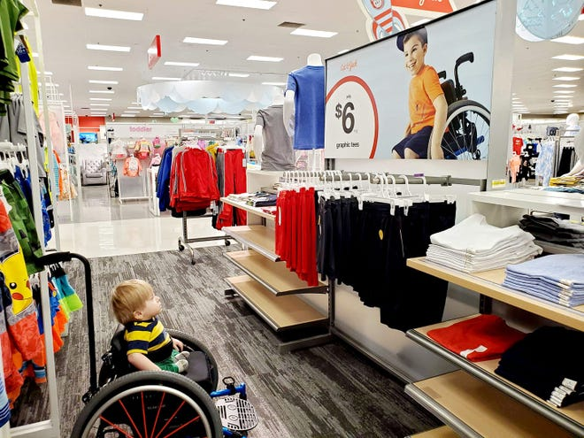 Demi P. Garza-Pena shared this photo of her son, Oliver, staring in awe at a Target ad in Peoria because he recognized a boy just like him, she said.