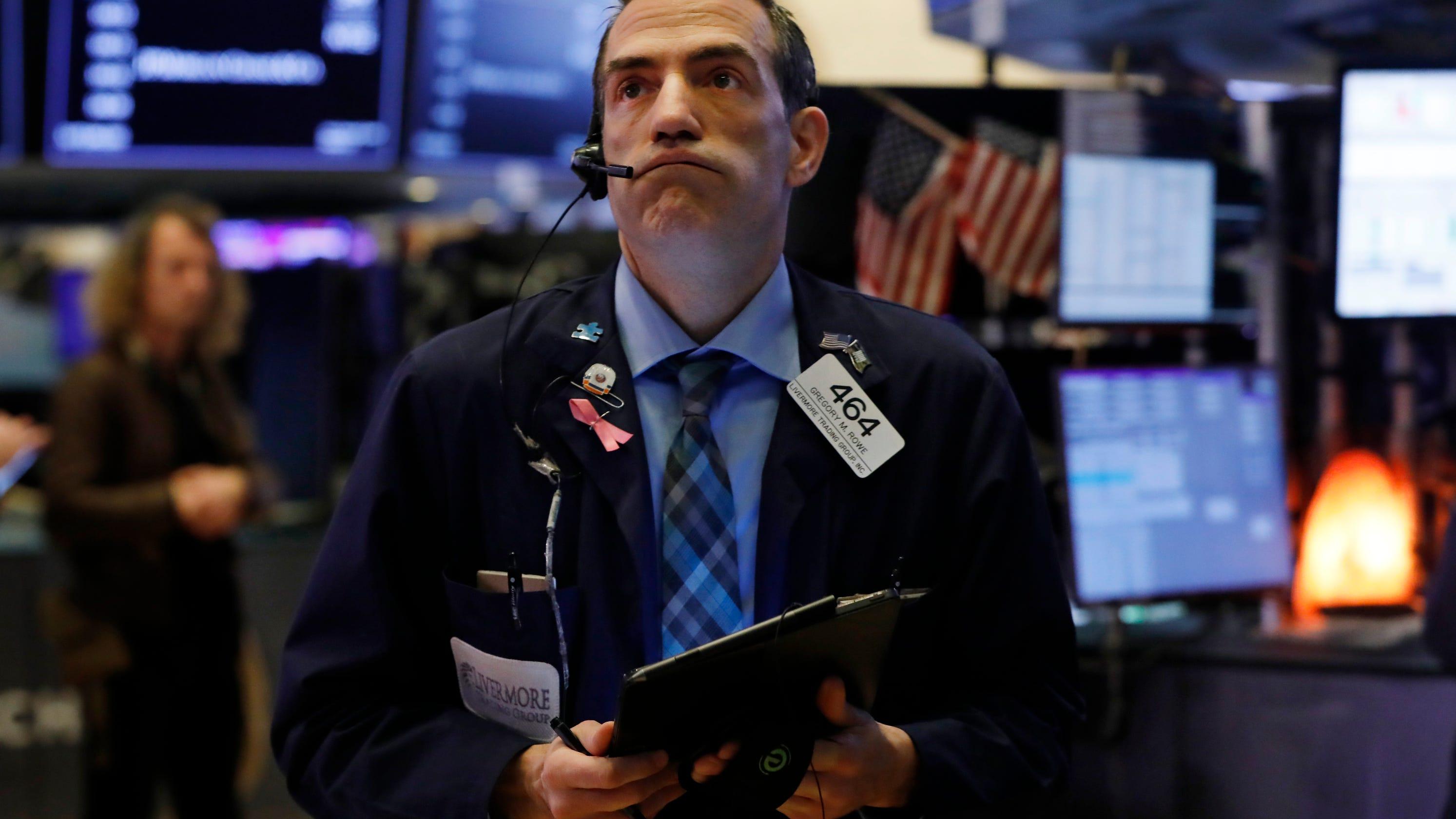Stocks drop as investors weigh dismal corporate earnings