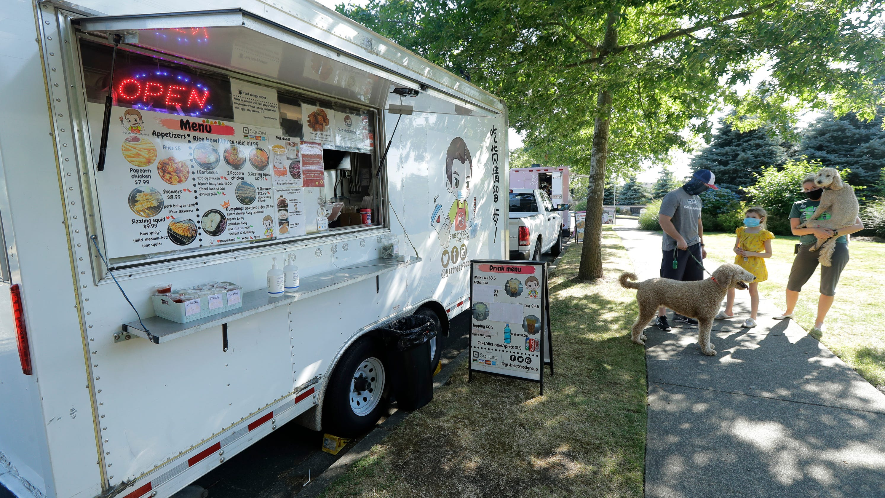 Food trucks hit by virus head to the suburbs to survive